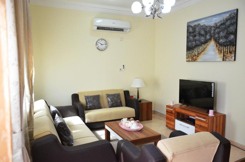 Posezení v ubytování Al Muntaza building 101