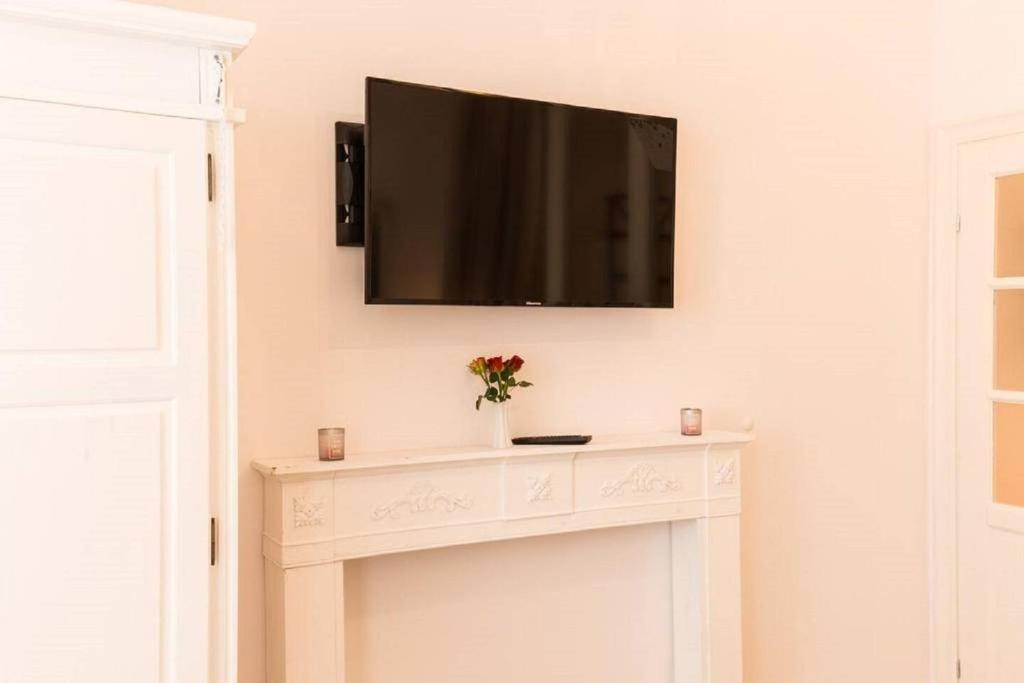 A television and/or entertainment center at cosy center apartment Berlin Mitte