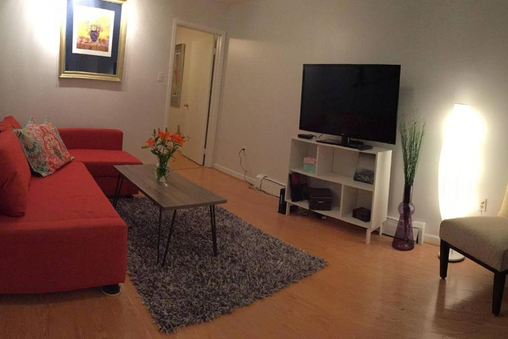 A television and/or entertainment center at Historic Center & Italian Market 2-Bedroom Apt