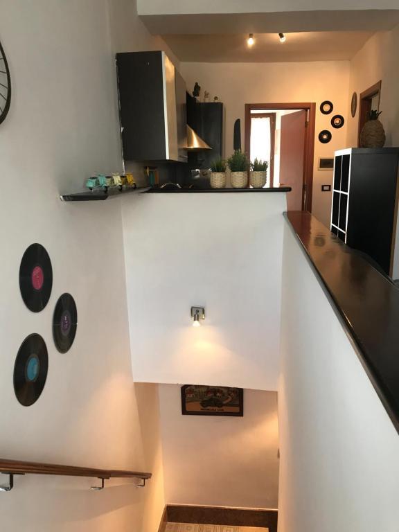 TV a/nebo společenská místnost v ubytování Al Varrone