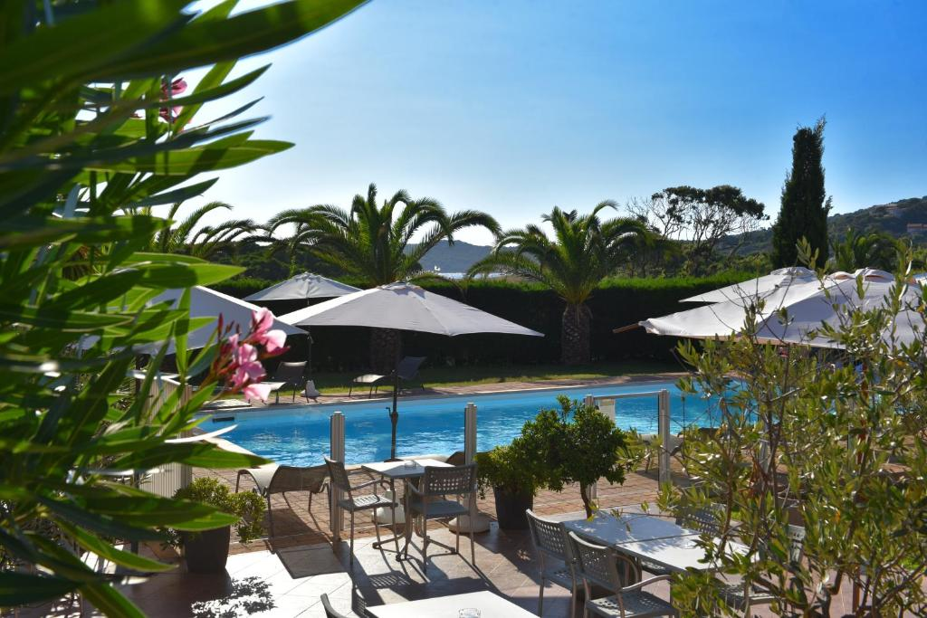 The swimming pool at or near Hôtel Les Lentisques