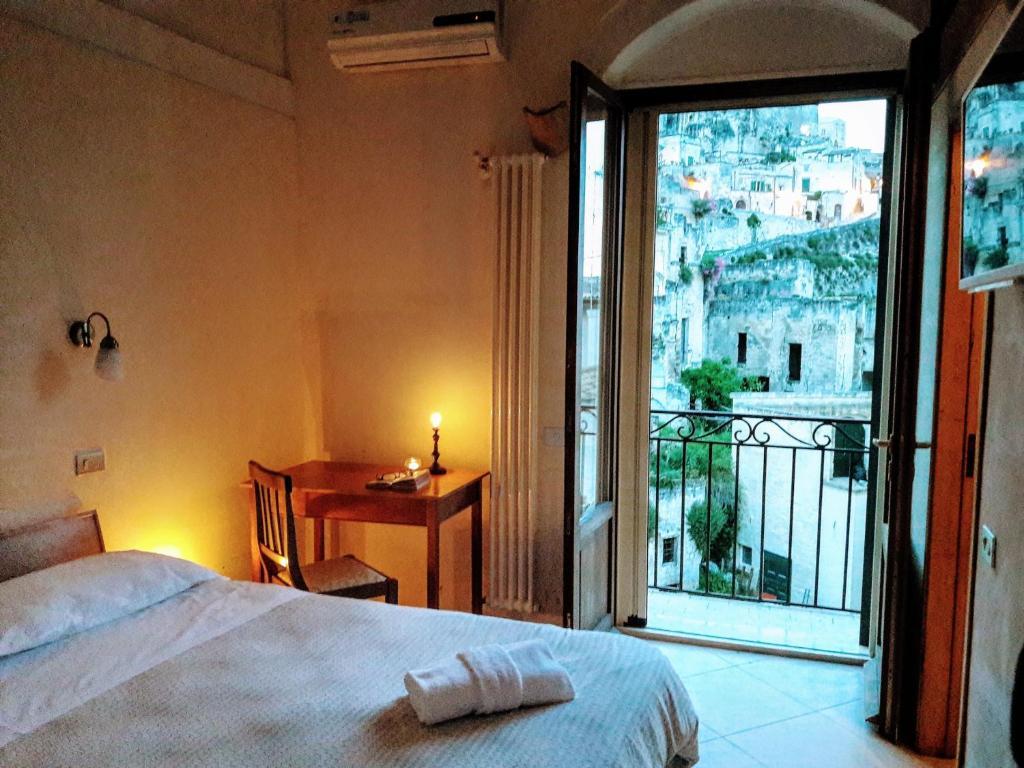 Ein Bett oder Betten in einem Zimmer der Unterkunft Saxum - Residenze del Caveoso