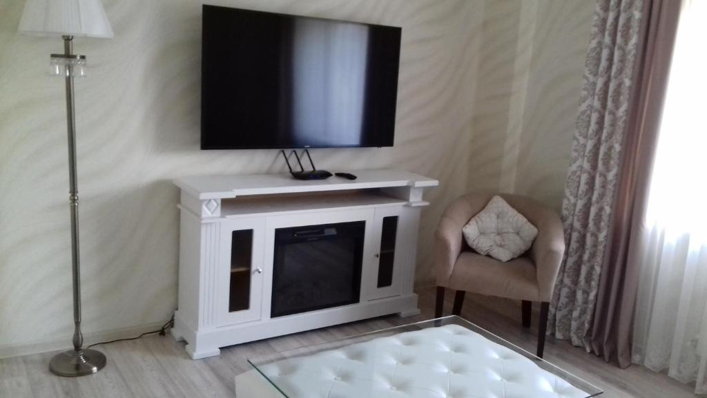 Телевизор и/или развлекательный центр в Апартаменты на Греческой