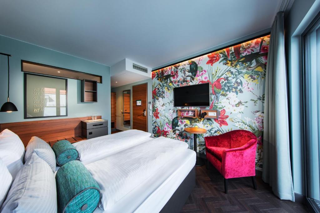 Ein Bett oder Betten in einem Zimmer der Unterkunft Maison Schiller by DesignCity Hotels