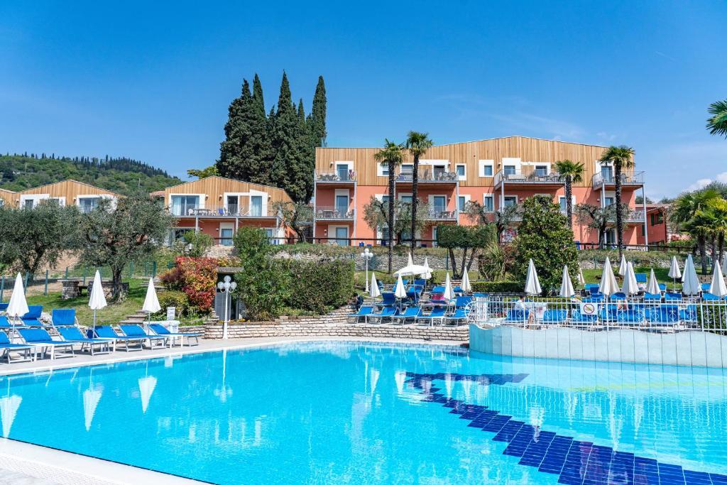 The swimming pool at or near Appartamenti Arca & Ca' Mure
