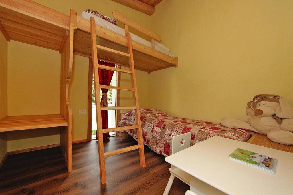 A bunk bed or bunk beds in a room at Holiday resort Fiemme Village Ballamonte di Predazzo - IDO01301-MYC