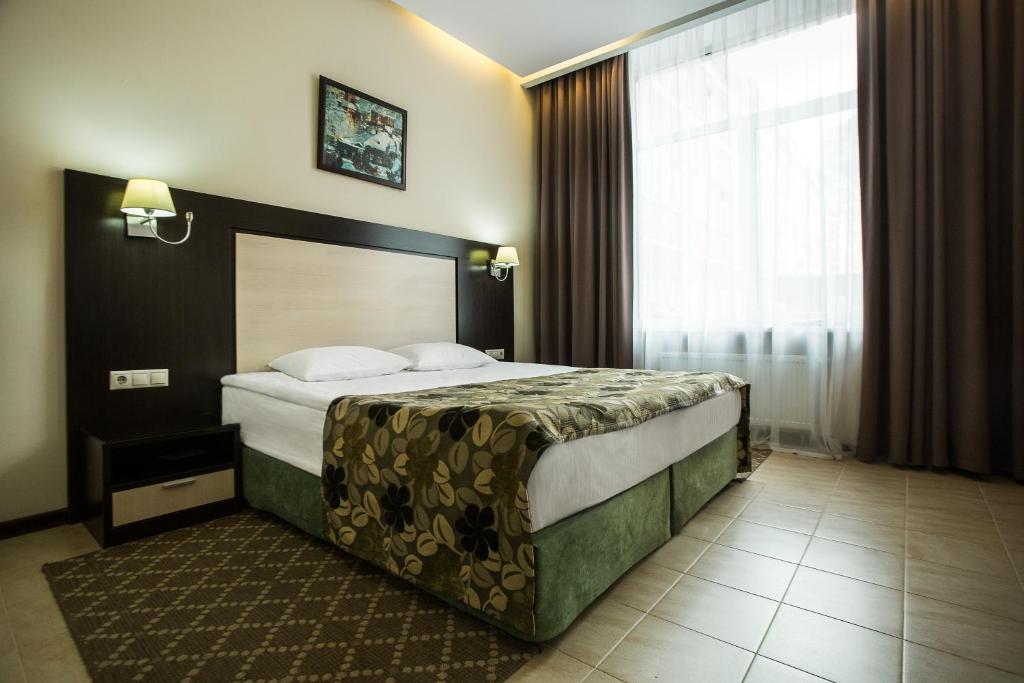 A bed or beds in a room at Vorontsovsky Hotel