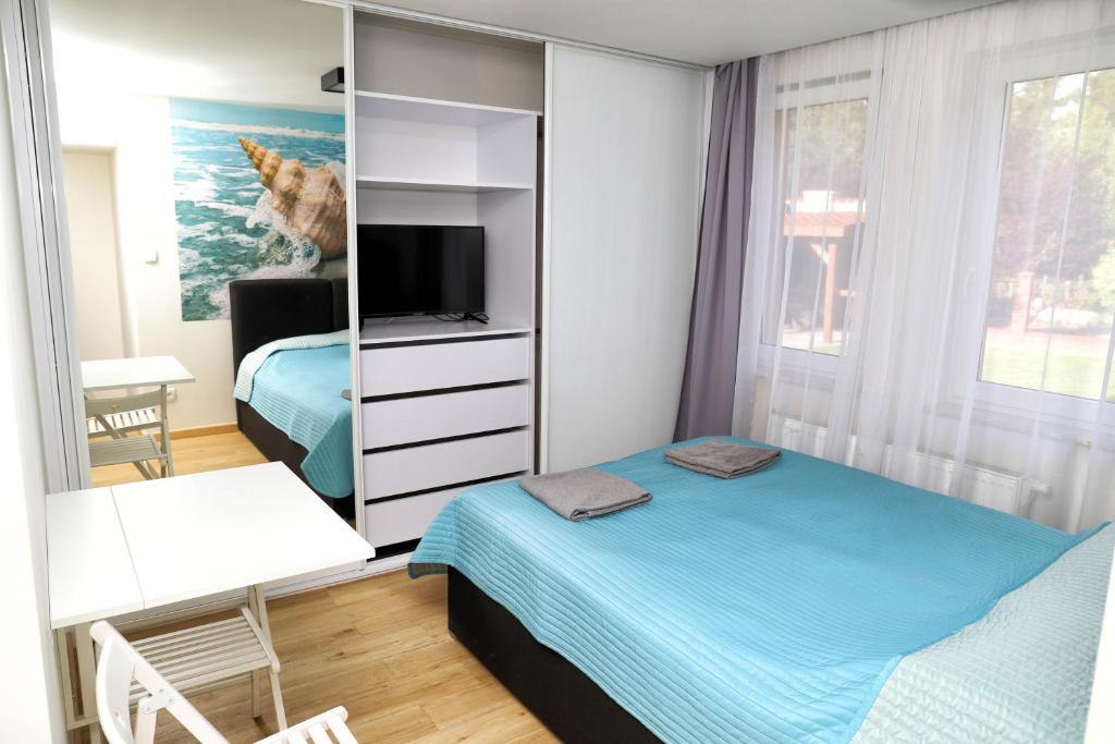 Łóżko lub łóżka w pokoju w obiekcie Osińscy