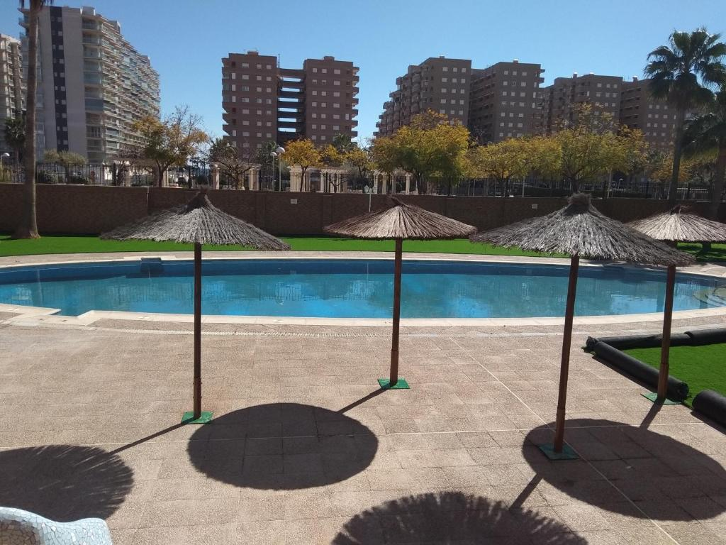 The swimming pool at or near ACV - Costa Marfil I-2ª Linea Planta 5 Norte