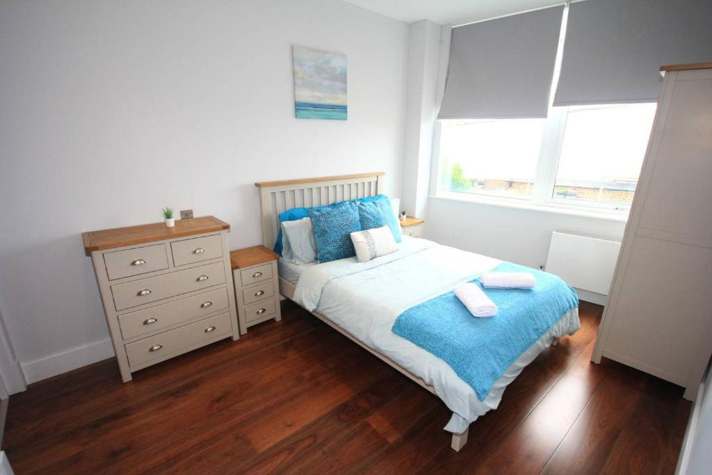 A bed or beds in a room at Glasshouse Court
