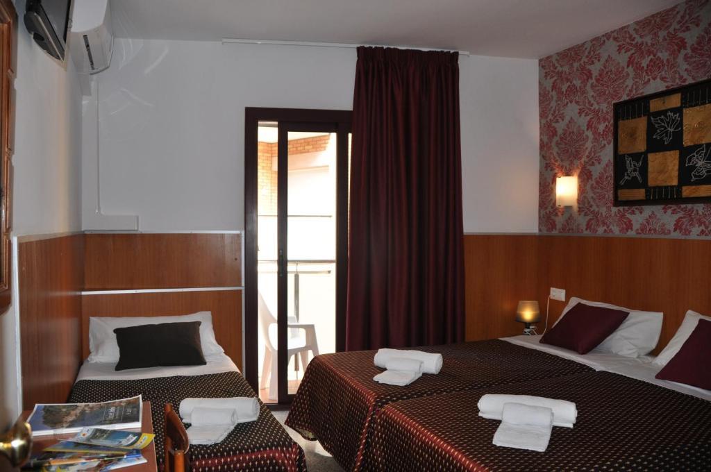 Posteľ alebo postele v izbe v ubytovaní Pensión El Amigo