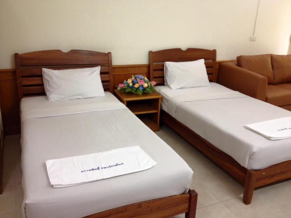 A bed or beds in a room at สรรพสิทธิ์อพาร์ทเม้นท์