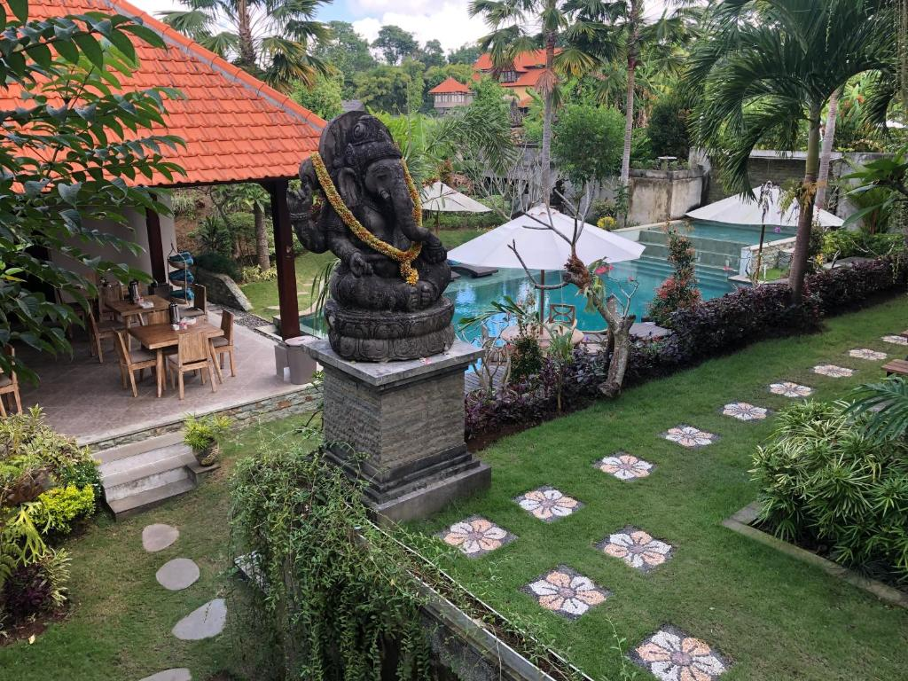 A view of the pool at Betutu Bali Villas or nearby