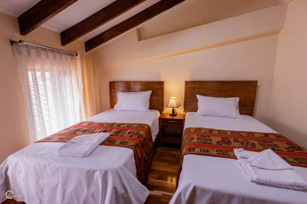 Cama o camas de una habitación en Quechua Hostal Recoleta