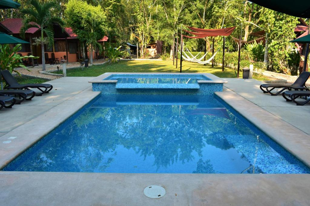 The swimming pool at or near Cabañas Kin Balam Palenque