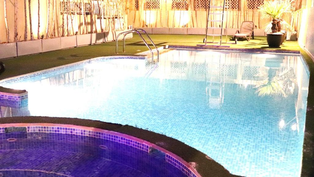 The swimming pool at or near Buraq Hotel by Gemstones