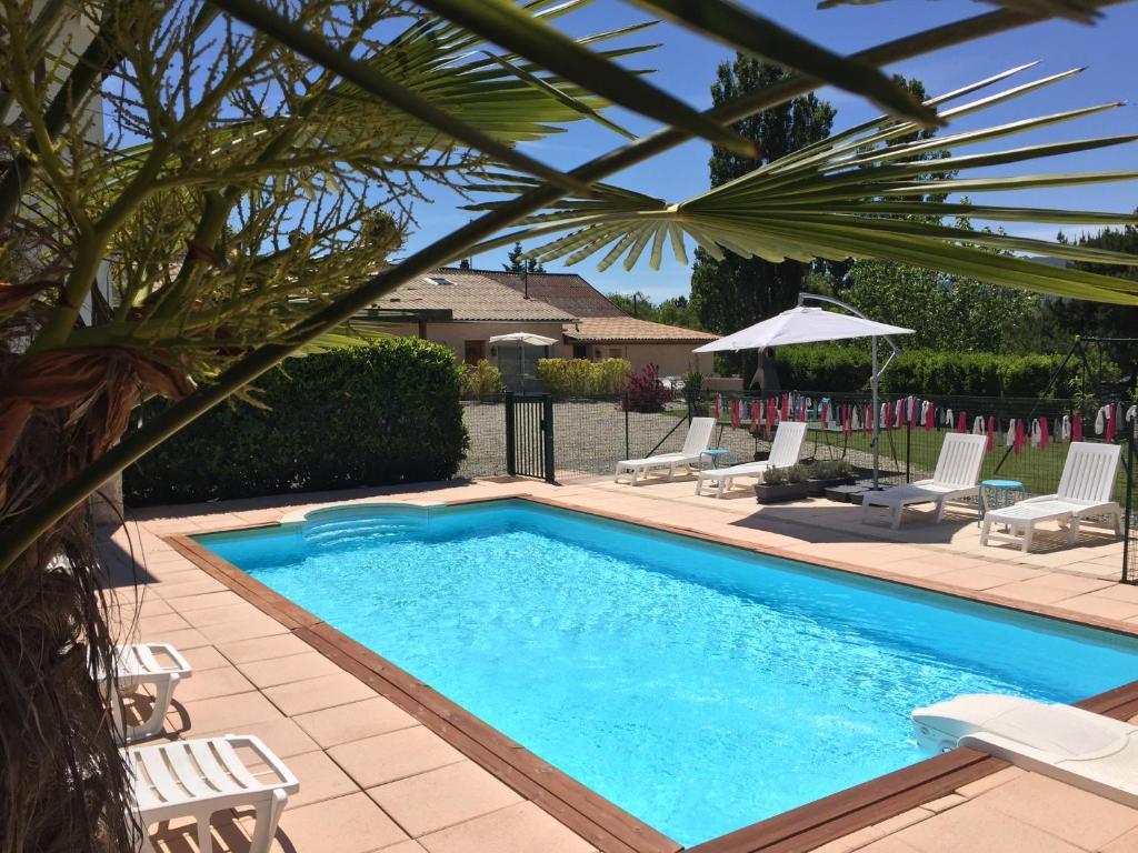 The swimming pool at or near Gîtes de La Condamine