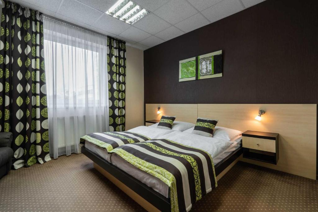 Кровать или кровати в номере BNC Hotel - Restaurant - Bowling