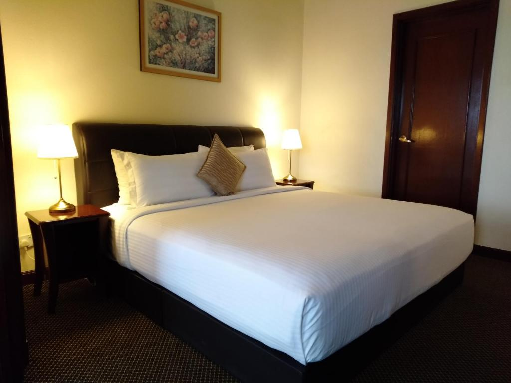 Кровать или кровати в номере Grand service apartment @ Time Square