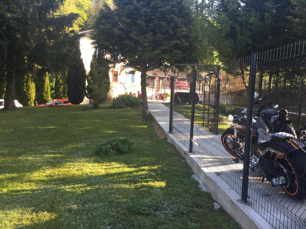 A garden outside La Table Des Bons Peres