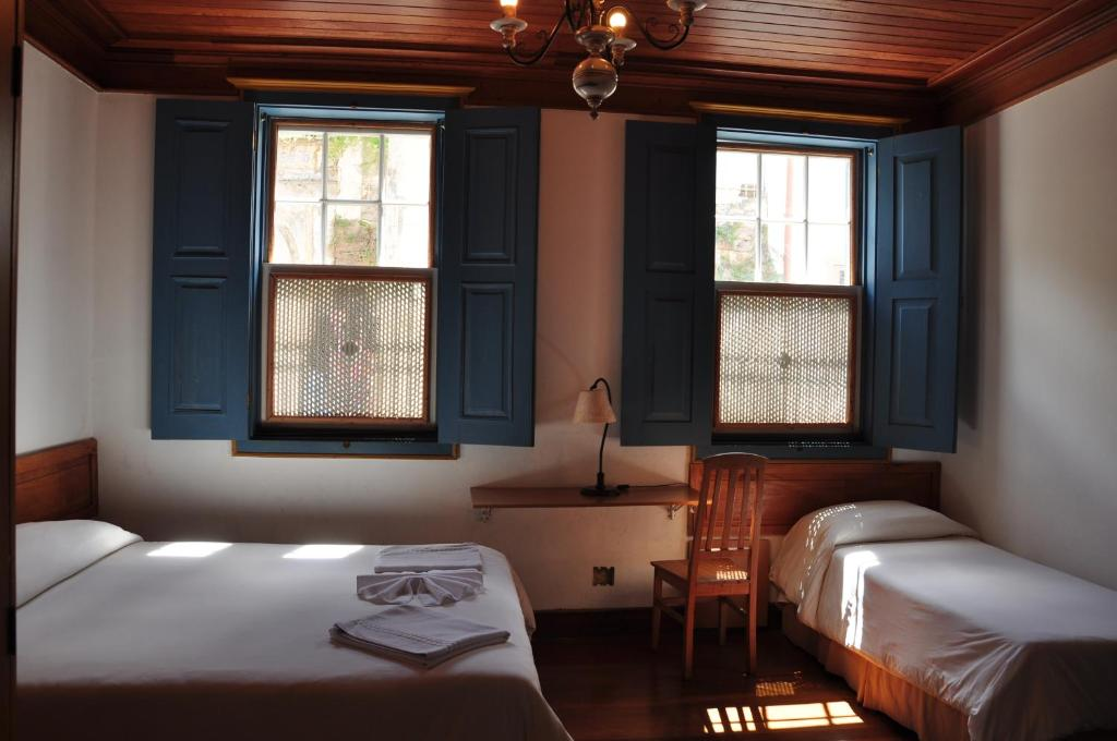 A bed or beds in a room at Hotel Solar de Maria