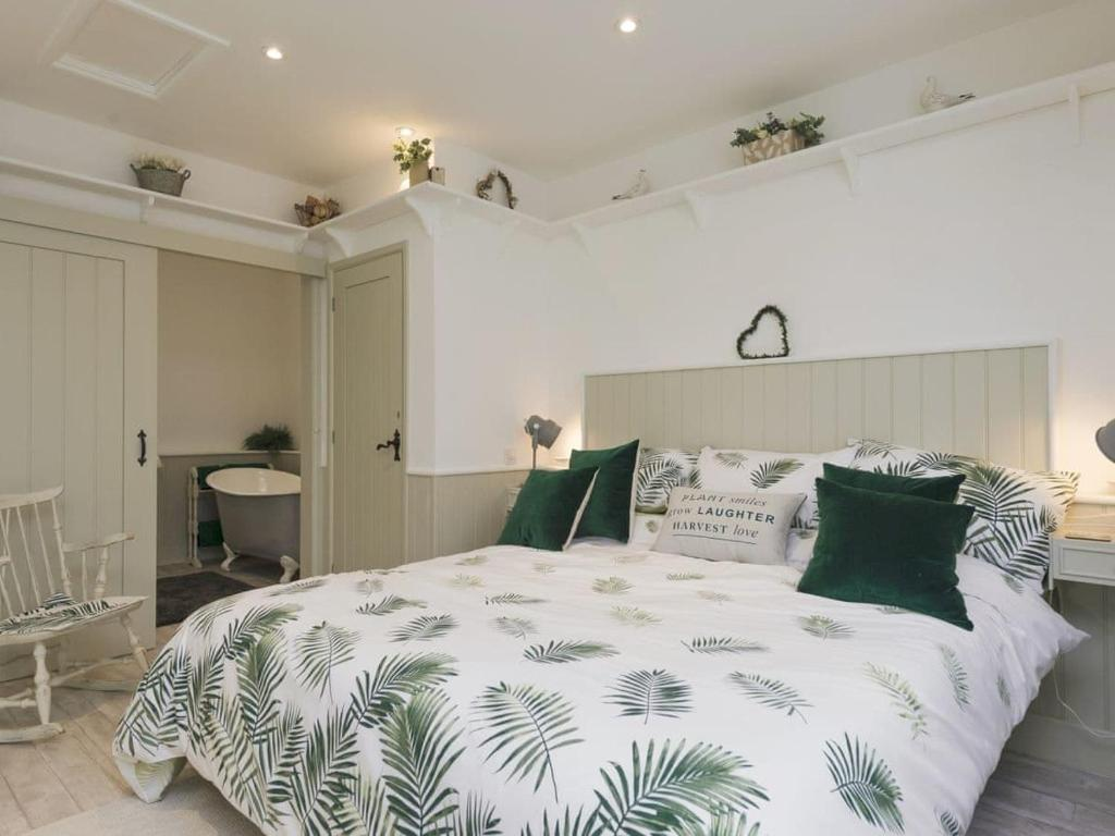 A bed or beds in a room at The Garden House