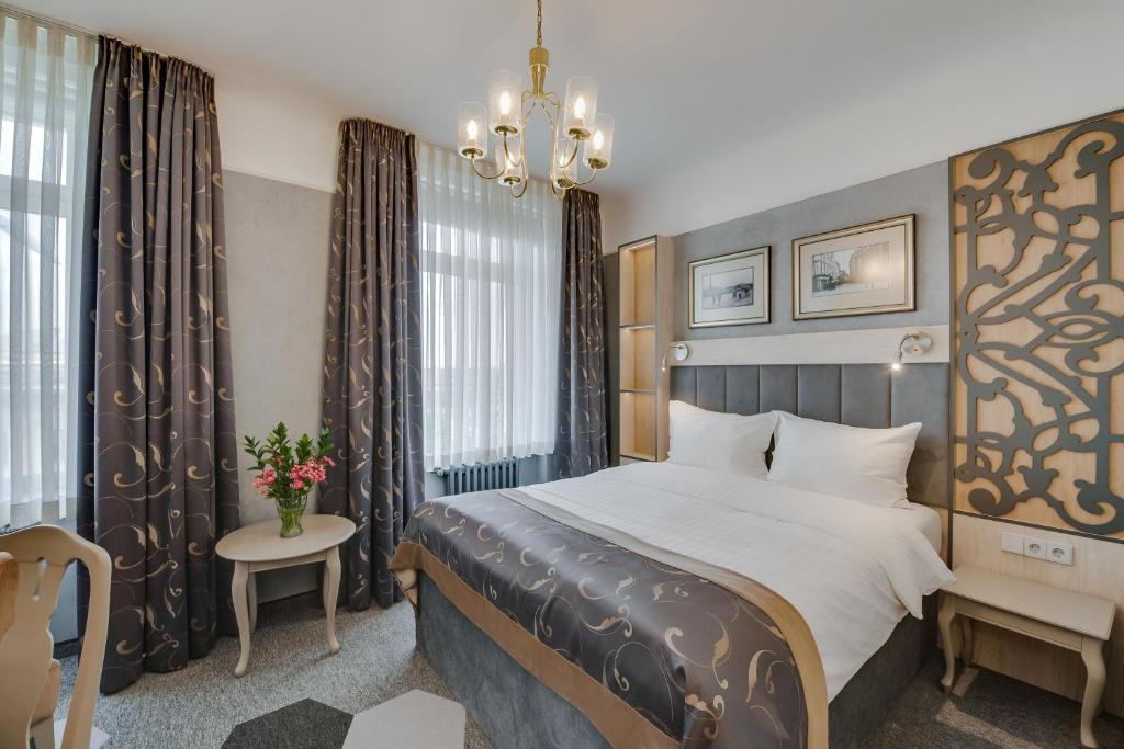Lova arba lovos apgyvendinimo įstaigoje Metropole Hotel by Semarah