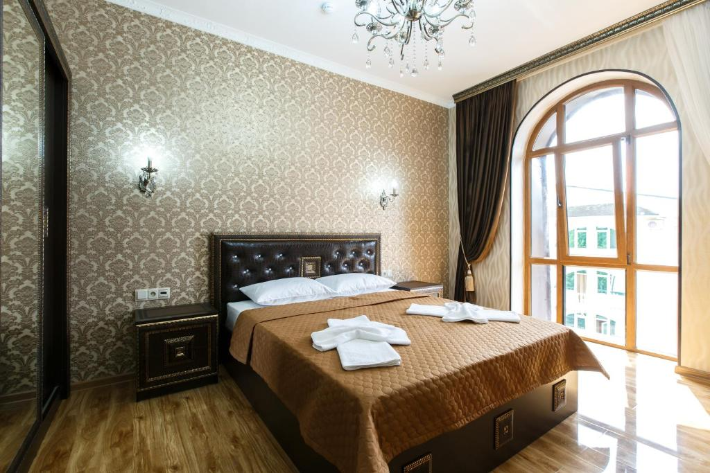A bed or beds in a room at Guest house Galina