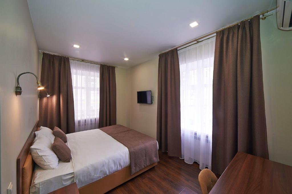 Ένα ή περισσότερα κρεβάτια σε δωμάτιο στο Forton Hotel