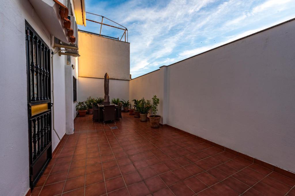 A balcony or terrace at Apartamento Turístico San Jorge