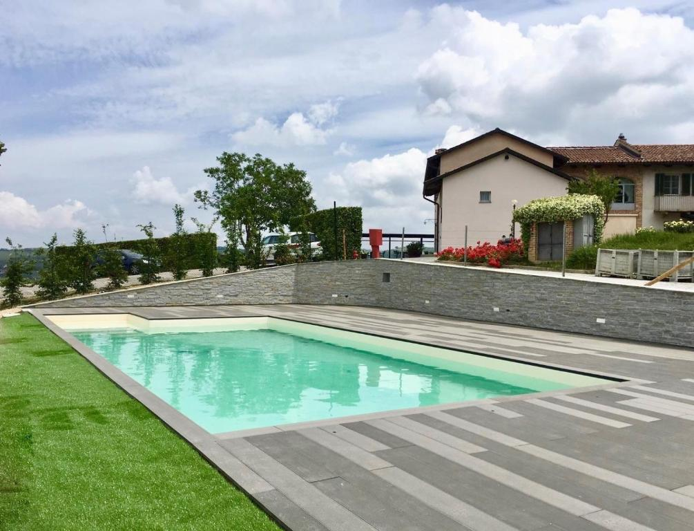 The swimming pool at or near Locanda Del Pilone