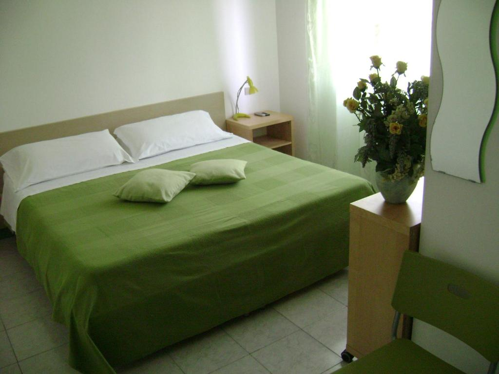A bed or beds in a room at Albergo Moderno
