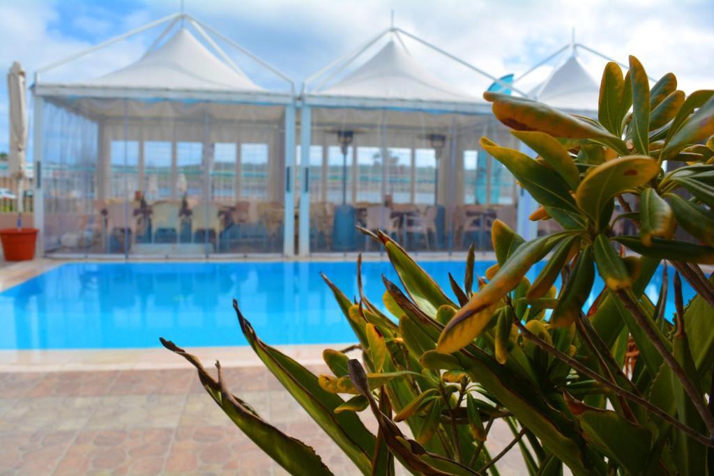 The swimming pool at or near Sensi Hotel