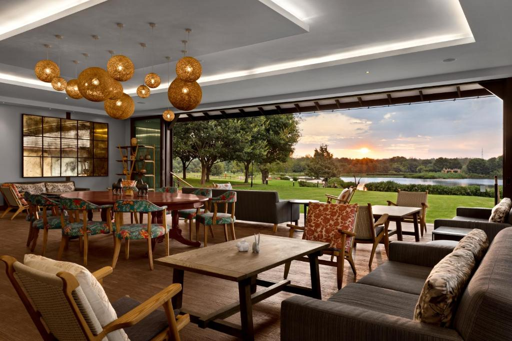 A restaurant or other place to eat at African Pride Irene Country Lodge, Autograph Collection