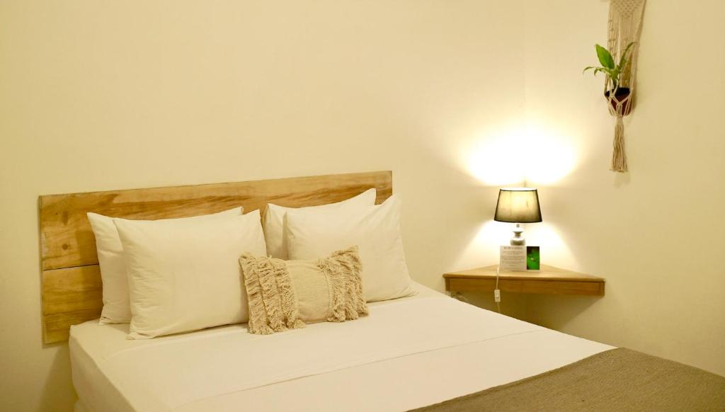 A bed or beds in a room at STAY Bocas