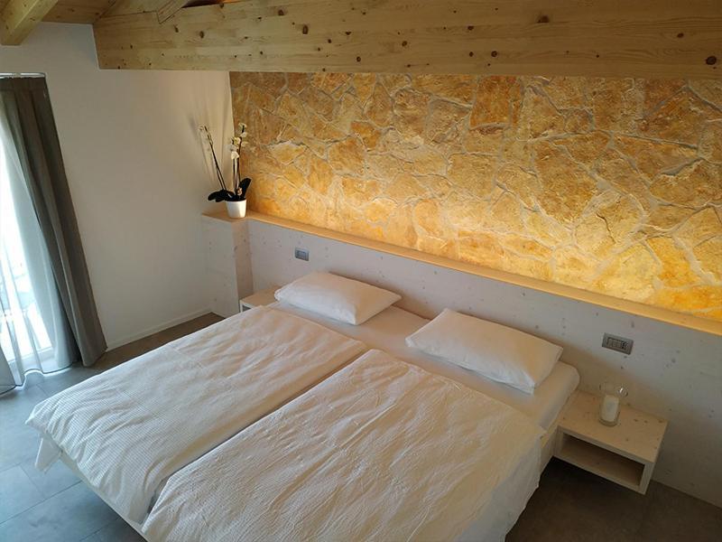 Letto o letti in una camera di Hotel Laguna