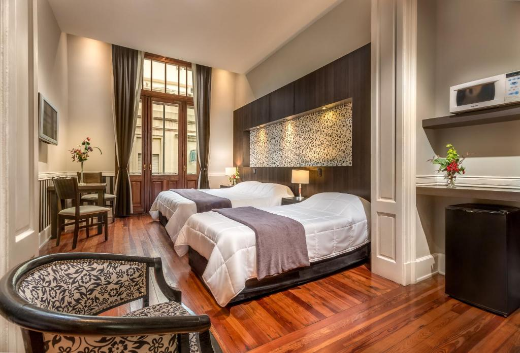 A bed or beds in a room at Tribeca Buenos Aires Apart