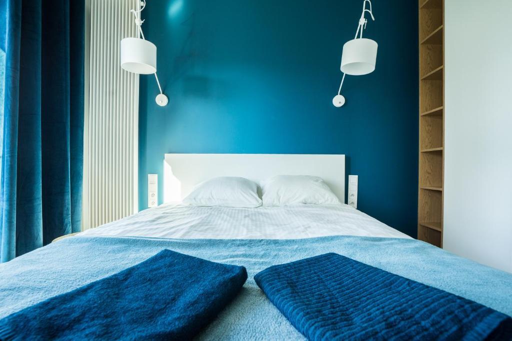 Ein Bett oder Betten in einem Zimmer der Unterkunft VIP Warsaw Residence Mennica Apartment