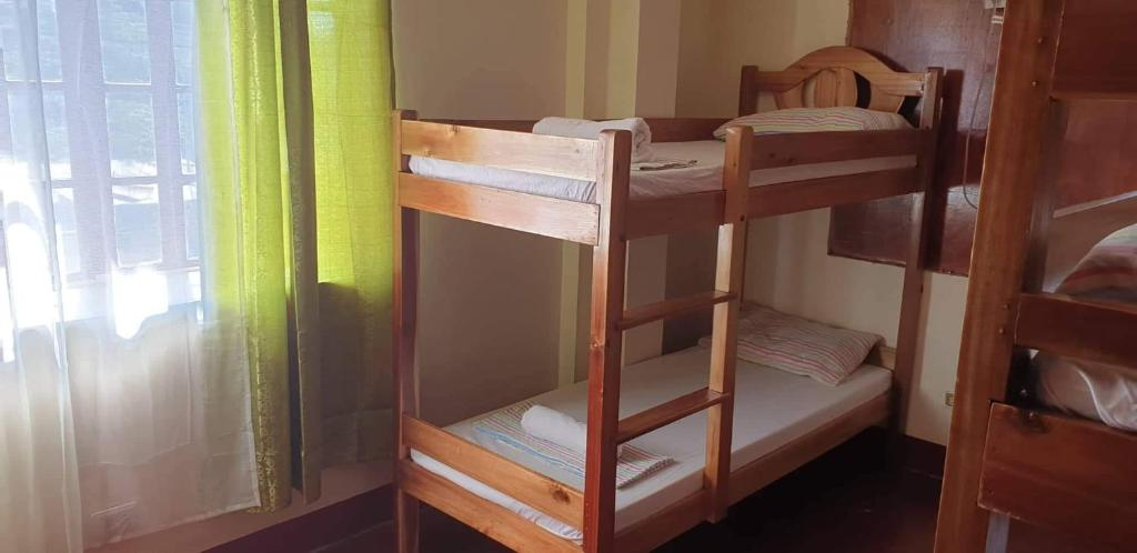 A bunk bed or bunk beds in a room at Your Hostel