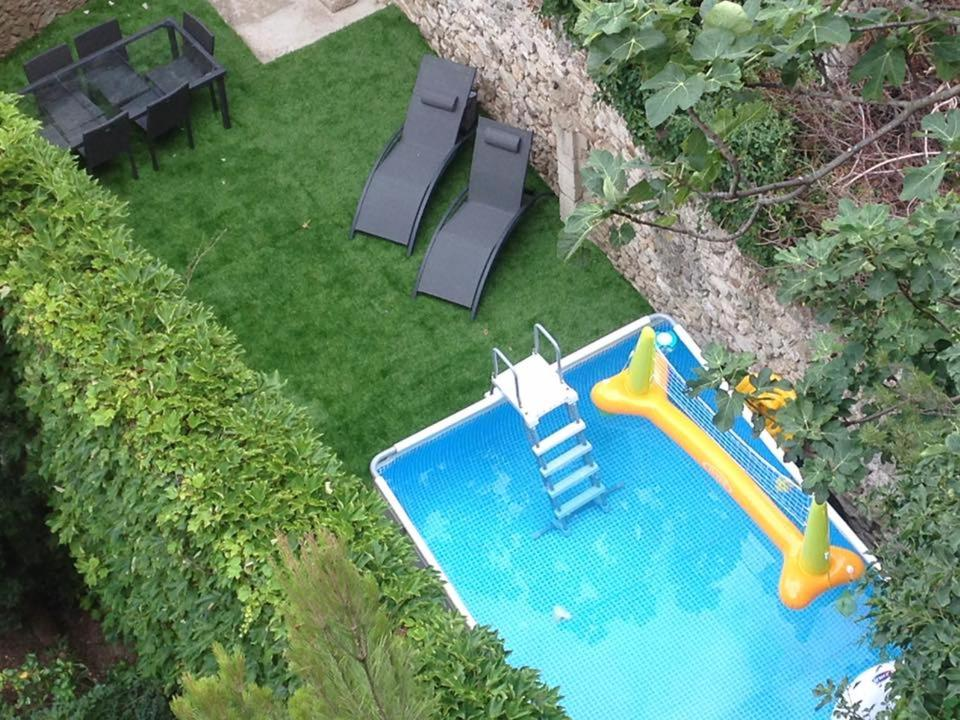 A view of the pool at Appartement avec terrain et piscine privative. or nearby