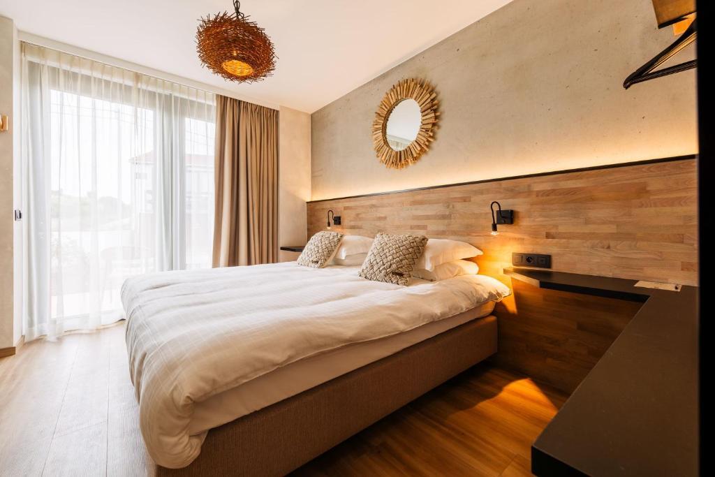 Un ou plusieurs lits dans un hébergement de l'établissement C-Hotels Zeegalm