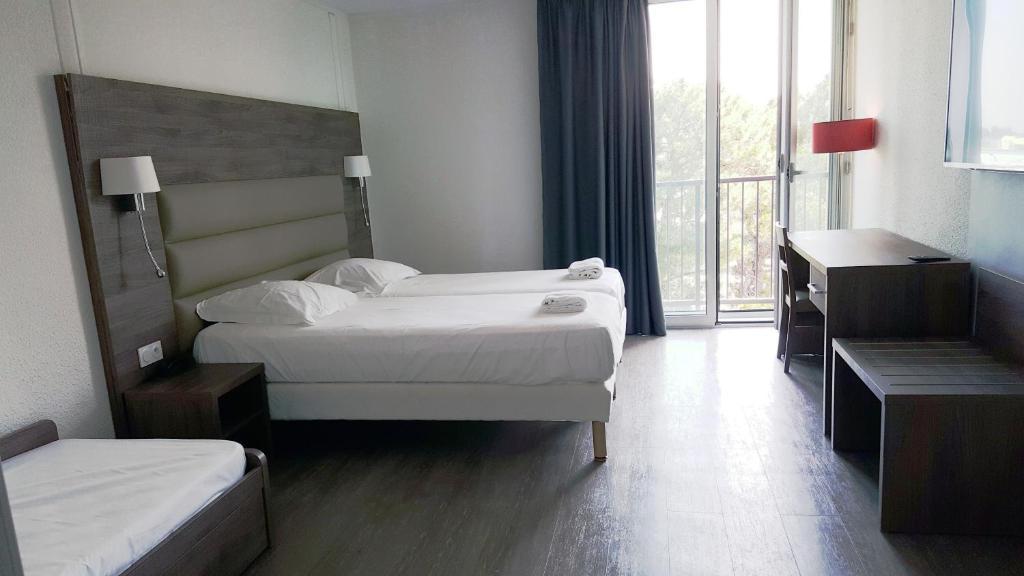 Un ou plusieurs lits dans un hébergement de l'établissement Yes Hotel