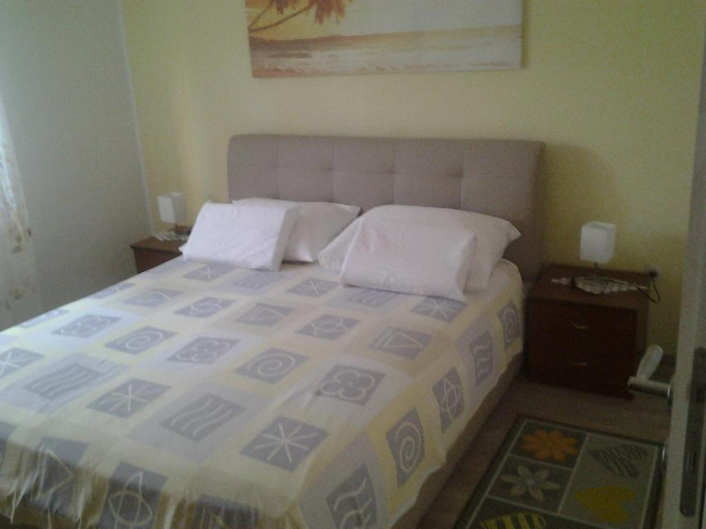 A bed or beds in a room at Apartment Mile