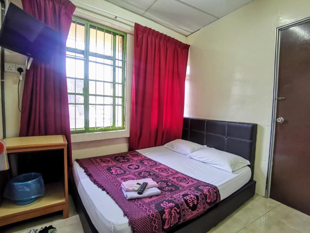 Postel nebo postele na pokoji v ubytování Ros Heritage Motel