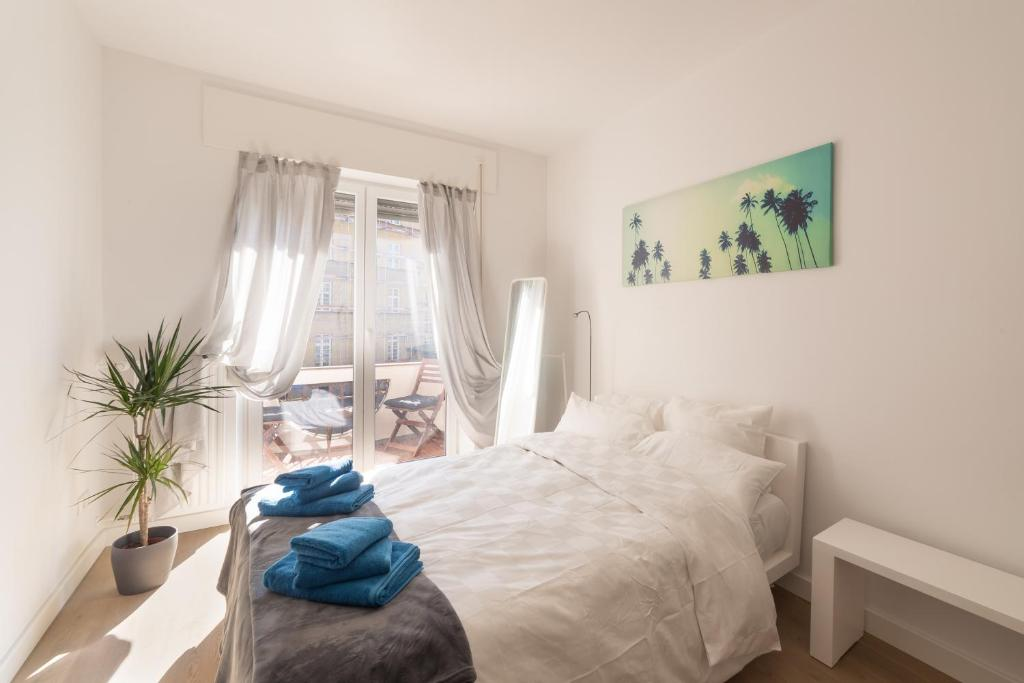 A bed or beds in a room at ☆ Moderne 90m² 3-Zimmer im Zentrum mit Netflix