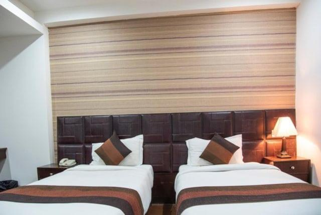 A bed or beds in a room at Hotel Patliputra Nirvana