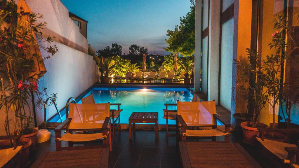 The swimming pool at or near Design Hotel Logatero