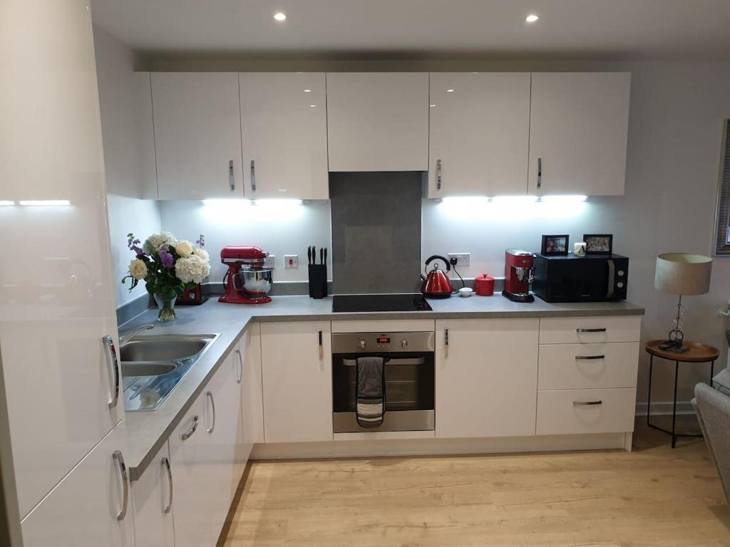 A kitchen or kitchenette at Flat 15 - Ben/Milsy