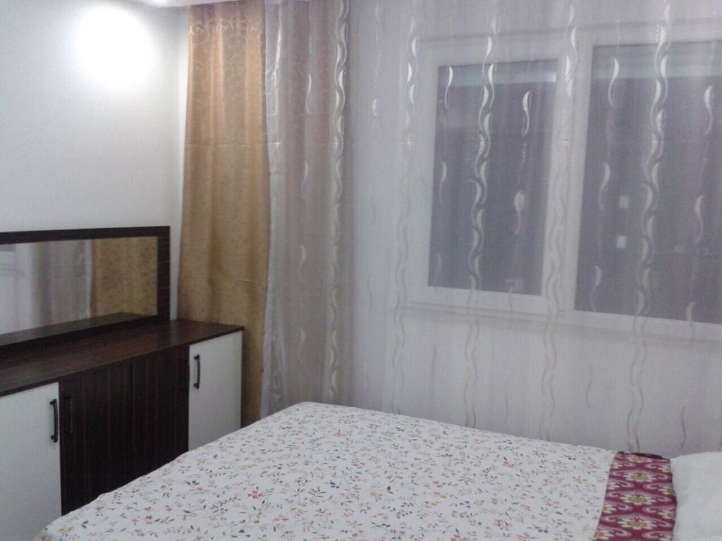 Кровать или кровати в номере Sunlight Residence
