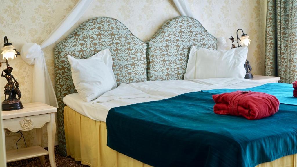 Lova arba lovos apgyvendinimo įstaigoje Grand Rose SPA Hotel